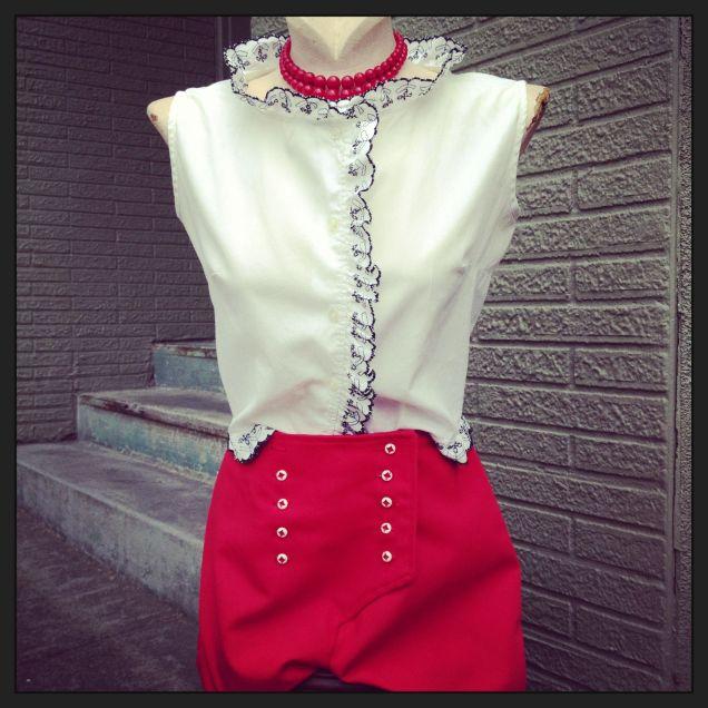 white shirt red shorts
